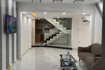 Nhà mới (100%) đường Hòa Bình, q. Tân Phú, 1T, 2L, nội thất cao cấp. LH: 0931426442