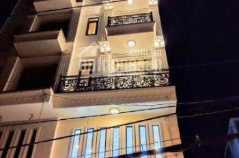 Bán nhà mặt tiền Dương Quảng Hàm, Gò Vấp, giá 13,8 tỷ, 5 tấm có thang máy, DT 4x18m. LH 0902422256