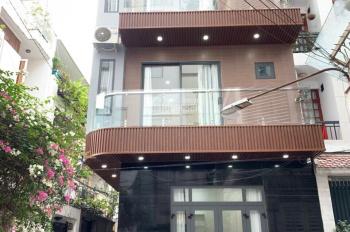 Cho thuê nhà mặt tiền Lạc Long Quân gần chợ Tân Bình. DT: 4x20m, nhà 2 tầng, chỉ 30 triệu/tháng.