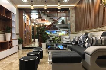 Nhà phố nội thất gỗ CC nằm ngay trung tâm quận đường Quang Trung,p11.DT:4x18m đúc 1lững,3L.Hẻm 5m