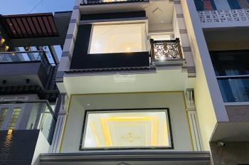 Nhà quận Bình Tân HXH 7m mới xây 5 tầng, (4x14,92)