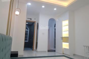 Cho thuê nhà quận 10 đường Vĩnh Viễn, P. 5, DT: 4x14m, giá: 42 triệu/th, T + 4L