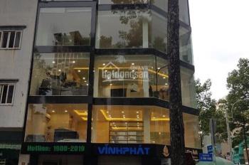 Bán nhà mặt tiền đường Nguyễn Chí Thanh, P. 9, Q. 5, DT: 11mx30m, DTCN 300m2, giá chỉ: 210tr/m2