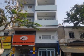Bán nhà MT Phạm Văn Đồng P3 Gò Vấp trệt lửng 3 lầu có 6 PN và mặt bằng giá 9.6 tỷ. LH 0935815862