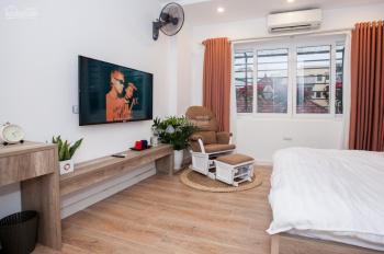 Bán toà CH 7 tầng Tây Hồ - Hà Nội, gồm 10 căn hộ cho thuê, DT 64m2, MT 4m10, 12 tỷ. LH 0963906328