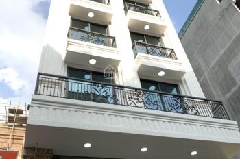 Cần cho thuê nhà khu Nguyễn Chánh, diện tích 110m2 * 6 tầng + 1 hầm, thông sàn, thang máy giá 150tr
