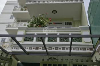 Bán biệt thự Thích Quảng Đức - Phú Nhuận. DT 5.2x25m (113m2), 4 tầng, sân đậu xe hơi, giá 12.5 tỷ