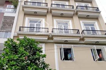 Bán nhà MT Trần Phú, P. 4, Q. 5, giá: 80 tỷ, DT: 9 x 33m, T + lửng + 3L + ST, thuê: 150 triệu/th