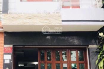 Bán nhà mặt tiền đường số 4 phường 16 quận Gò Vấp DT 4,1x20 trệt lầu