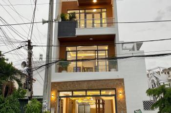Bán nhà mặt tiền đường nhựa 20m Huỳnh Tấn Phát, DT: 5mx16m, 3.5 tấm, có garage xe hơi, giá: 7,5 tỷ