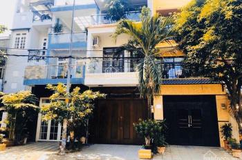 Nhà đẹp đường thông 10m Phổ Quang, gần Novaland DT 5x24m*4 tấm còn mới. Giá 19 tỷ LH 0944513773