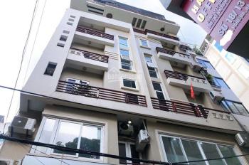 Bán tòa văn phòng Thái Hà 8 tầng, Đống Đa, oto đi lại - 179m2 siêu đẹp