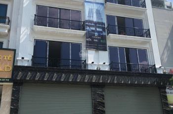 Cho thuê nhà MP Vũ Tông Phan - Thanh Xuân - HN. DT 120m2, 7T, 1 hầm thông sàn, có thang máy nhà mới