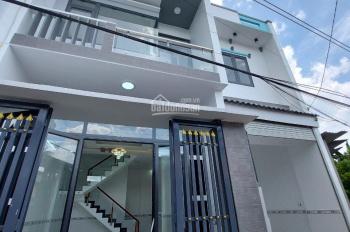 Bán nhà 1 lầu 1 trệt, sân xe hơi thuộc đường Nguyễn Thái Học vào 50m, gần chợ Dĩ An