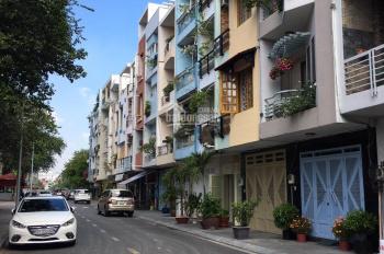 Bán nhà góc 4 tầng đường Khánh Hội (gần đường 48) Quận 4, Dt: 6x13m, giá: 12 tỷ