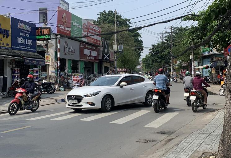 Cần bán nhà mặt tiền Nguyễn Văn Quá, Q12 Dt: 7,1m X 21m. Nhà có lửng, giá: 14,5 tỷ còn TL