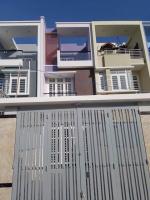 bán gấp nhà mới xây 1 trệt 2 lầu cách chợ thủ đức 150m