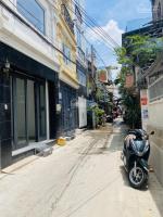 bán nhà mới xây trệt 2 lầu ô tô đậu trong nhà cách mt vũ tùng 20m khu giáp q1