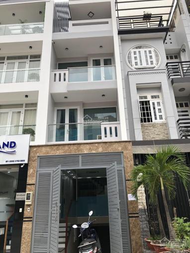 Cho thuê nhà mặt tiền Trần Lựu, An Phú, Q.2, ngay cục thuế, 1 hầm+1 lửng+3 lầu+thang máy, 55 triệu