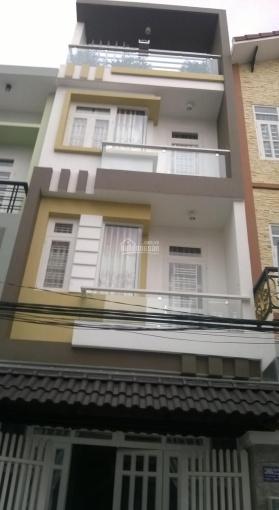 Nhà 1 trệt 3 lầu đường Thích Minh Nguyệt, P2, Q. Tân Bình, giá 14tr/th. LH: 0938313896
