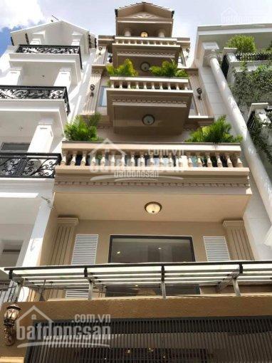 Đi Mỹ bán gấp nhà HXH đường Nguyễn Cảnh Dị, Phường 4, quận Tân Bình (4,4mx16m) giá 10,3 tỷ