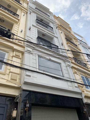 Nhà mới 100% 2 lầu hẻm xe hơi Vũ Tùng trung tâm Bình Thạnh gần chợ Bà Chiểu và Q1