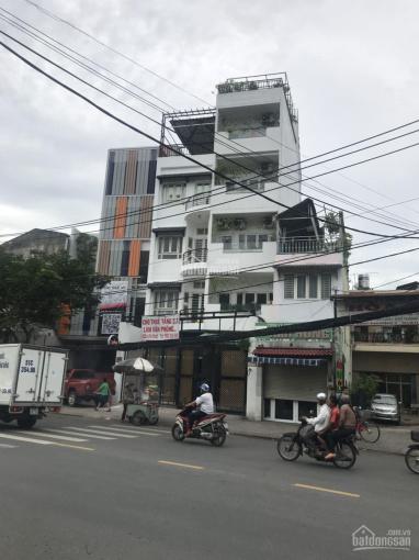 Bán nhà mặt tiền chợ vải ngay Lê Minh Xuân, P. 7, Q. Tân Bình, 4 x 27m, trệt, 2 lầu, giá 17 tỷ ảnh 0
