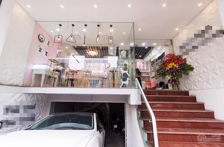 Cho thuê nhà MT La Thành góc Hào Nam 70m2 x 6 tầng + hầm MT 6m sàn thông có điều hòa, giá 48 tr/th ảnh 0