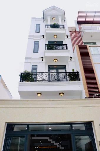 Nhà Thống Nhất 4x15m, 3 lầu, sổ hồng riêng, đường xe hơi, gần chợ ảnh 0
