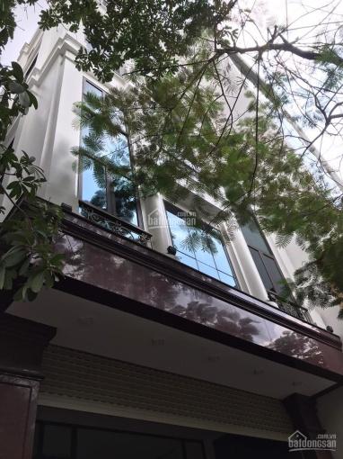 Cho thuê nhà mới xây mặt phố Vũ Tông Phan, 100m2 * 7 tầng, có hầm, thang máy, 80tr/1 tháng ảnh 0