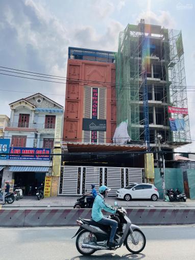 Cần bán 2 toà nhà MT Huỳnh Tấn Phát, Q7. DT 10.7x18m, 10x40m XD trệt 7 lầu, HĐ thuê 300tr/th, 33Tỷ ảnh 0