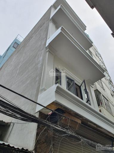 Cần bán gấp nhà tại Khương Đình, DT: 50m2 x 4 tầng, lô góc. MT: 4m, ngõ ô tô đỗ, SĐCC ảnh 0