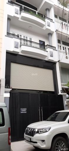 Bán nhà Cách Mạng Tháng 8, DT: 5.5x20m 3 lầu, có gara ô tô, giá chỉ 15 tỷ TL. Tel: 0925288699 ảnh 0