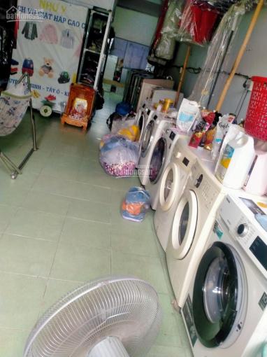 Sang tiệm giặt ủi hấp quần áo và giày dép ảnh 0