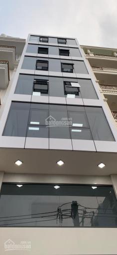 Nhà MT Lê Quang Định, 5,5x20m, hầm 7 lầu thang máy, 100 triệu, TL, nhà mới xây ốp kính siêu đẹp ảnh 0