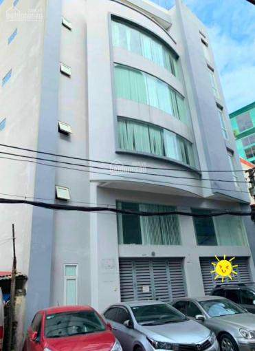 Bán toà nhà văn phòng, ô tô đỗ cửa, 6 tầng, mặt tiền 12m, giá 13.5 tỷ ảnh 0