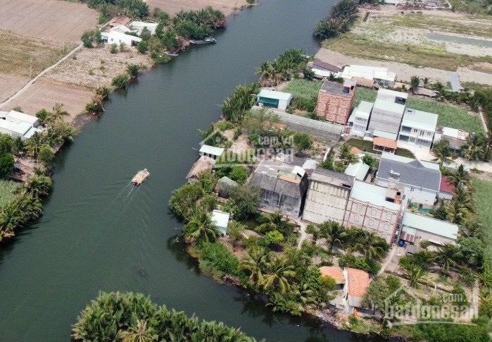 Bán đất mặt tiền đường tái định cư, mặt sông Vàm Mương, đường to 16m, có thổ cư sẵn ảnh 0