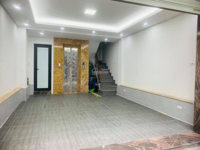Bán nhà mặt ngõ Nguyễn Ngọc Vũ 35m2 x 7 tầng mới cứng, mặt tiền 5m, thang máy 7.5 tỷ ô tô đỗ cửa ảnh 0
