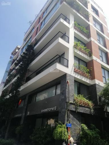 Tòa nhà VP phố Thái Hà mới đét, lô góc 2 thoáng, vỉa hè rộng, 135m2 x 9 tầng, MT 8m - 0976289915 ảnh 0