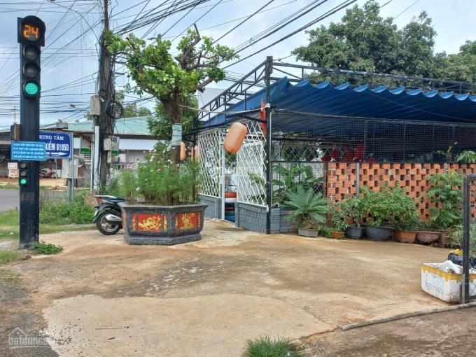 Nhà tôi kẹt tiền bán lô đất mặt tiền đường Hùng Vương nối dài. Diện tích: 100m2, thổ cư, sổ hồng ảnh 0