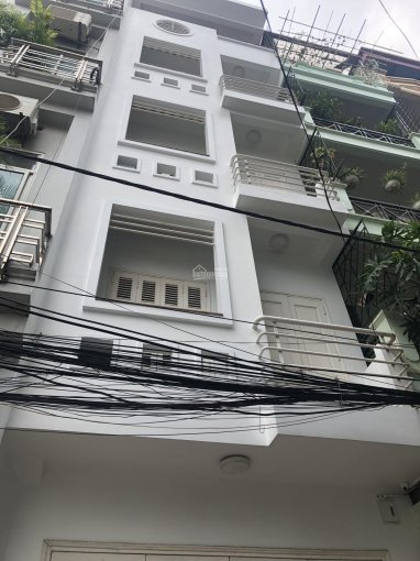 Cho thuê nhà ngõ ô tô tại Chùa Láng, Đống Đa. DT: 70m2 * 5 tầng, MT: 5m ảnh 0